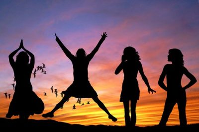Women celebrating jumping for joy