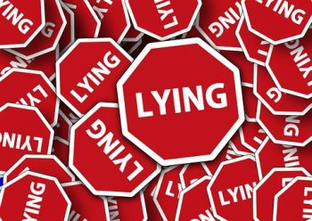 bunch of signs that say Lying